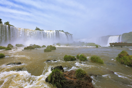 thundering: Fantastically spectacular boiling and thundering waterfalls of Iguazu. Waterfalls in Brazil