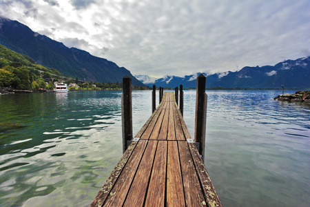 Boat wooden pier on Lake Leman. Montreux, Switzerland on  sunny day photo