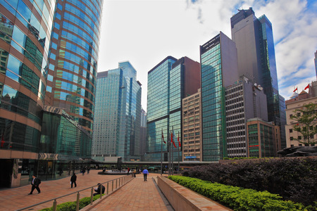 administrative buildings: HONG KONG - DECEMBER 11, 2014: Hong Kong Special Administrative Region. Super-modern architectural design of buildings in Hong Kong. Mirrored walls and red marble sidewalks