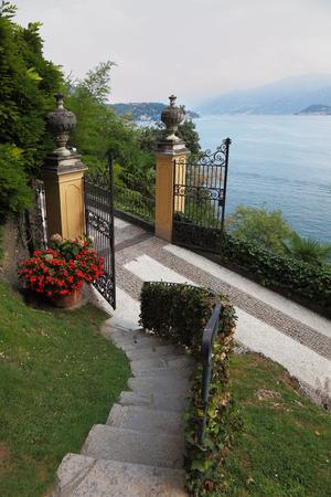 Luxurious historic villa on Lake Como. The gate to the park photo