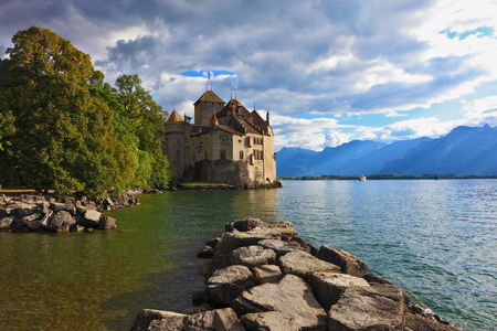 chillon: Lake in the mountains. Cold sunset Lake Geneva in the fall on  sunny day. Montreux, Switzerland Editorial