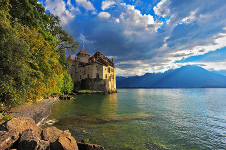 chillon: Cold  lake in the mountains. Lake Geneva in the fall on a sunny day. Montreux, Switzerland