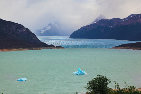 colossal: Colossal Perito Moreno glacier in Lake Argentino. Los Glaciares National Park in Argentina. Wintry summer day
