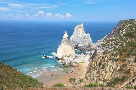 resembling: Two picturesque cliffs of white sandstone, resembling a portion of ice cream. Atlantic coast of Portugal