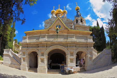 mount of olives: Mount of Olives in Jerusalem. The facade of the church of St. Mary Magdalene white marble.  Above the triangular portico golden domes topped with golden crosses