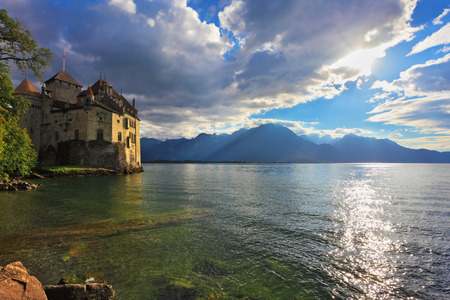 chillon: Lake in the mountains. The beginning of autumn in Montreux, Switzerland. Lake Leman in fine weather