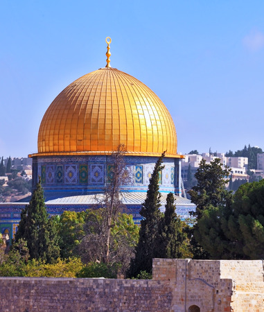omar: Golden Dome Mosque of Caliph Omar. The Holy City of Jerusalem is lit by the morning sun. Stock Photo