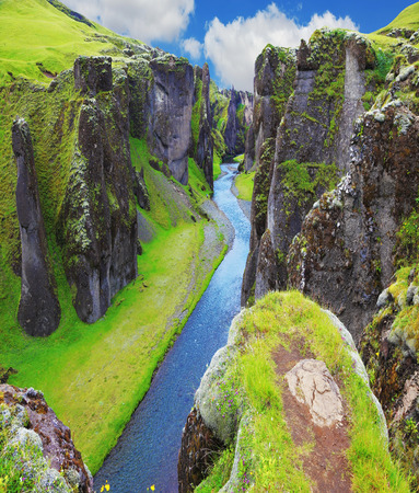 crevice: The most picturesque canyon Fjadrargljufur  and the shallow creek, which flows along the bottom of the canyon. Fantastic country Iceland