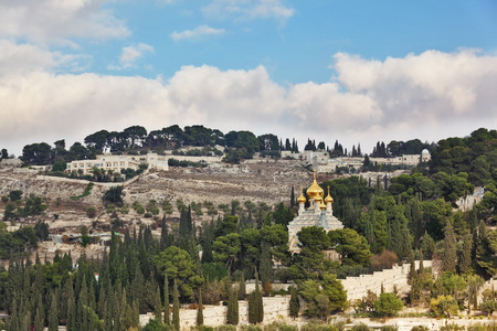 mount of olives: Golden domes of Orthodox church of Mary Magdalene. Ancient holy Jerusalem from the Mount of Olives