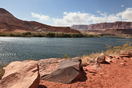 abrupt: A reservation of Indians of the Navajo, the USA. Magnificent cold water the river Colorado in abrupt coast from red sandstone