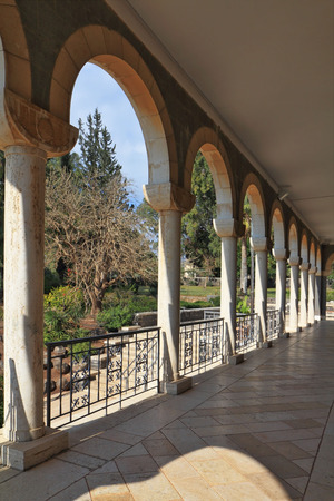 holyland: Church on Mount of Beatitudes. Israel, lake Tiberias. The marble gallery with columns surrounds the Basilica Stock Photo