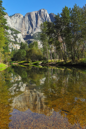 merced: The famous valley of the Merced River in Yosemite. In the clear water reflecting the mountains and the trees Stock Photo