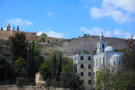 surmounted: Christian monastery in Jerusalem, Israel. Beautiful bell tower surmounted by a cross