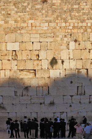jewish group: JERUSALEM - OKTOBER 9: A large group of religious Jews and secular three men near the Western Wall of Jerusalem Temple Oktober 9, 2010 in Jerusalem, Israel