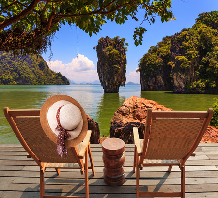 lounges: Exotic rest in Thailand. The coast of the gulf in the Andaman Sea. Two convenient chaise lounges and an elegant hat on one