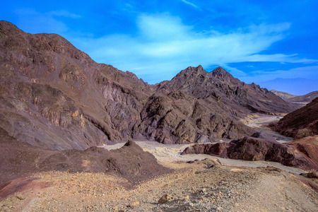 eilat: Foot road to Amrams Columns. Multi-colored mountains of Eilat, Israel. Warm January day