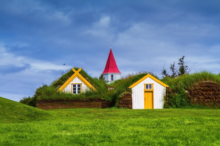 pioneers: The village of ancestors in Iceland. The recreated village -  museum of pioneers - Vikings. Houses are roofed by the turf