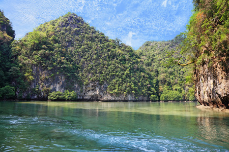 secluded: Emerald water lapping at the cliffs. A secluded cove off the coast of Thailand.