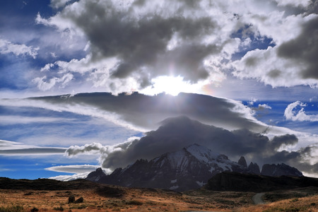 glisten: Incredible shaped cloud formed by glaciers glisten in the sun.
