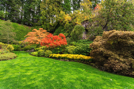 walking paths: Butchart Gardens -  gardens on Vancouver Island. Flower beds of colorful flowers and walking paths for tourists. The world-famous masterpiece of park architecture