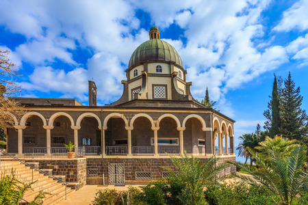 the sermon: The majestic dome of the basilica is surrounded by a gallery with columns. Church Sermon on the Mount - Mount of Beatitudes. Sea of Galilee, Israel
