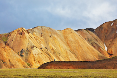 remained: Snow remained on the mountains since last year. Pink and orange Mountains National Park Landmannalaugar in Iceland