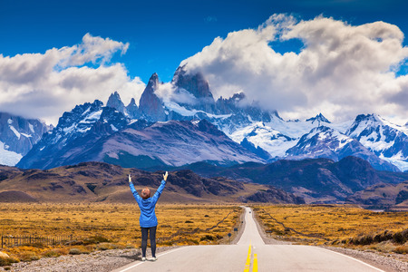 fitzroy: Woman delighted natural beauty raised her hands. The highway leads to the snow-capped peaks of Mount Fitzroy