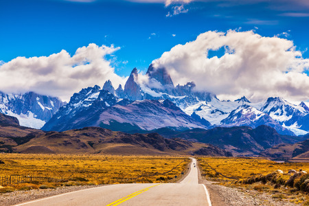 The road through desert. The highway crosses Patagonia and conducts to majestic Mountains Fitzroy Stock Photo