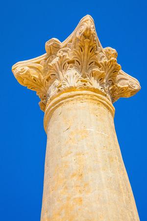 roman column: Magnificent Roman column against the blue sky Stock Photo