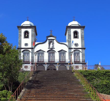 conducts: Sights of the Portuguese island of Madeira. To the magnificent white church  the long picturesque ladder conducts Stock Photo