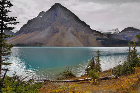 pyramidal: Mountain of the correct pyramidal form in northern Canada, reflected in lake Stock Photo
