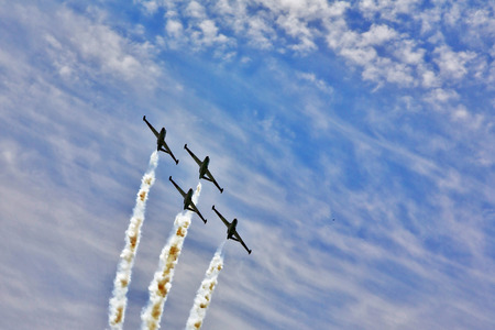synchronous: Synchronous  flight of four sparkling planes on air parade