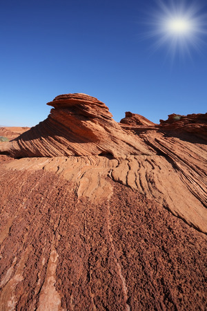 trampled: Walking around the famous Horseshoe Canyon in the U.S.. Shining sun in the blue sky