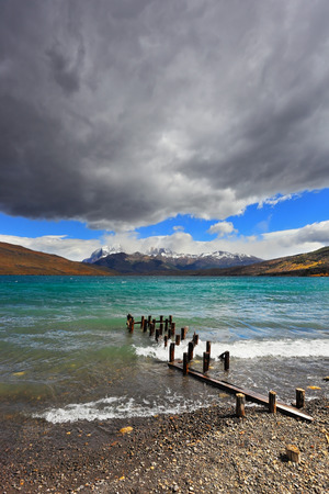 azul: National Park Torres del Paine in Patagonia, Chile. Boat dock on the lake. Storm clouds, wind and waves at the Laguna Azul.