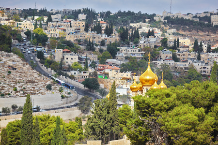 mount of olives: Golden domes of an Orthodox church of Mary Magdalene. Ancient holy Jerusalem from the Mount of Olives