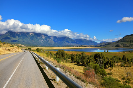 ruta: Patagonia. The longest road the Ruta 40 passes in Argentina among lakes and fields. The picturesque mountain chain of the Southern Andes decorates a landscape Stock Photo