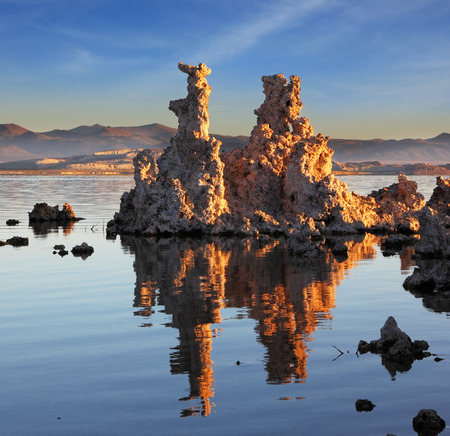 calcareous: Yosemite National Park, USA. Outliers -  bizarre calcareous tufa formation  reflected in the mirrored surface of the water. The picturesque sunset at Mono Lake Stock Photo