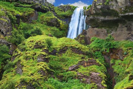 waterfall: Gorgeous high waterfall near Selyalandfoss. Iceland, July Stock Photo