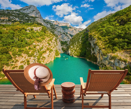 lounges: Travel across Provence. Two wooden chaise lounges on platform at the lake Verdon Stock Photo