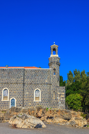 primacy: The Holy Church was built on Lake of Gennesaret. The Church of the Primacy - Tabgha. Jesus then fed with bread and fish hungry people Stock Photo