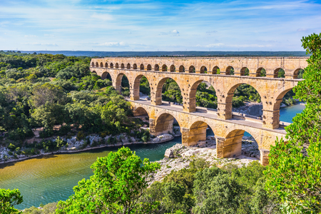 water stone: Three-tiered aqueduct Pont du Gard was built in Roman times on the river Gardon. Around the bridge is magnificent natural park. Provence, spring sunny day
