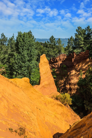 roussillon: Multi-colored ocher outcrops - from yellow to orange-red. Roussillon, Provence Red Village. The picturesque canyon of ocher - natural dyes