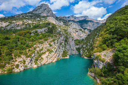 descend: Mercantour National Park, Provence. The rocky slopes of canyon Verdon descend into the azure river Stock Photo