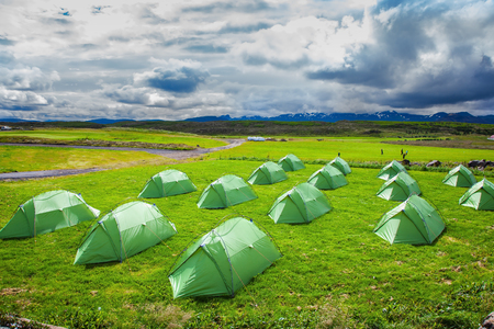 campground: Campground in Iceland. Green tent on a grassy lawn. Stock Photo