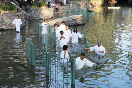 baptize: Yardenit, Israel - January 21: Christian pilgrims ritual baptism in the waters of the Jordan River in the days of the Feast of Holy Baptism 21 January 2012 at Pilgrim baptismal site Yardenit, Israel. Pilgrims enter the water, dressed in special white chri Stock Photo