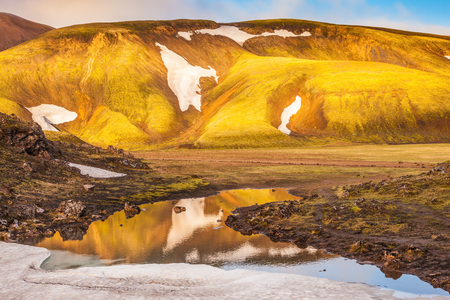 glaciers: Light golden dawn illuminates the mountains and glaciers . The  sunrise in national park Landmannalaugar, Iceland