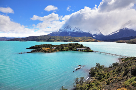 torres del paine: National Park Chile - Torres del Paine. Island Lake Pehoe and comfortable hotel. Easy bridge connects the hotel and the beach Stock Photo