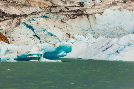 descends: Massive glacier descends into the water.  The picturesque  shore of Lake Viedma. In the water ice-floes, broken away from glacier Stock Photo