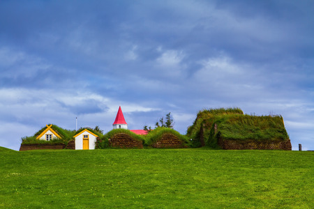reconstituted: The village ancestors. The reconstituted village - a museum of the first settlers in Iceland. Roofs of houses covered with turf and grass