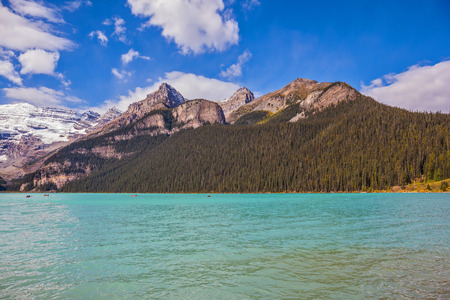 national forests: Banff National Park, Canada, Alberta. Magnificent Lake Louise with emerald green water surrounded by the Rocky Mountains, pine forests and glaciers Stock Photo